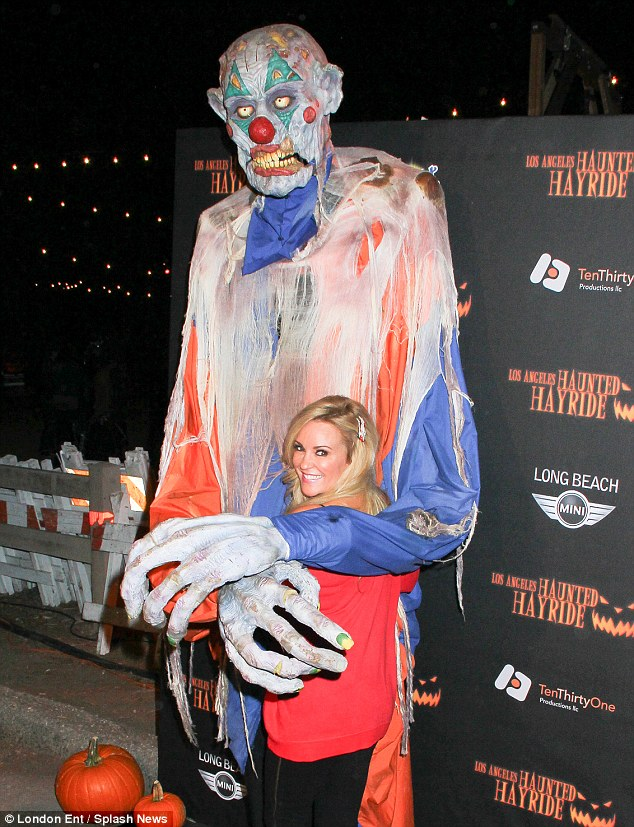 Just clowning around: Bridget Marquardt could not help but run up to the scariest looking creature she could find for a hug
