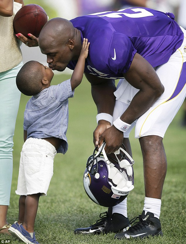 Family matter: It appears Adrian Peterson's two-Year old son has been severely beaten by his mother's boyfriend