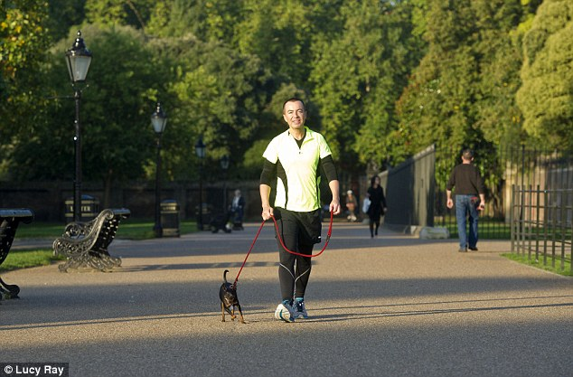 Autumn adventure: Julien appeared to have roped in his pet pooch to his training plan for this week's show