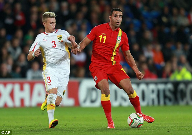 Advancing: Hal Robson-Kanu plays a pass under pressure from Ezgjan Alioski