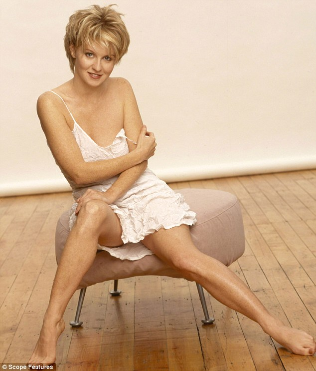 Exposed: McVey dons a slinky white dress in this seductive shot