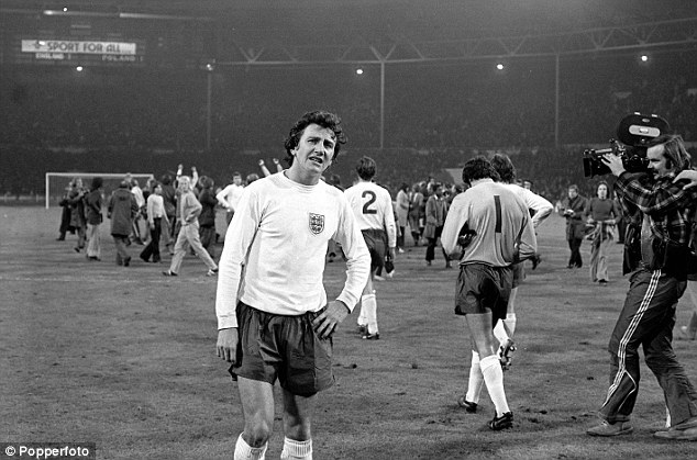 Dejected: Roy McFarland almost in tears as he leaves the Wembley pitch after the match