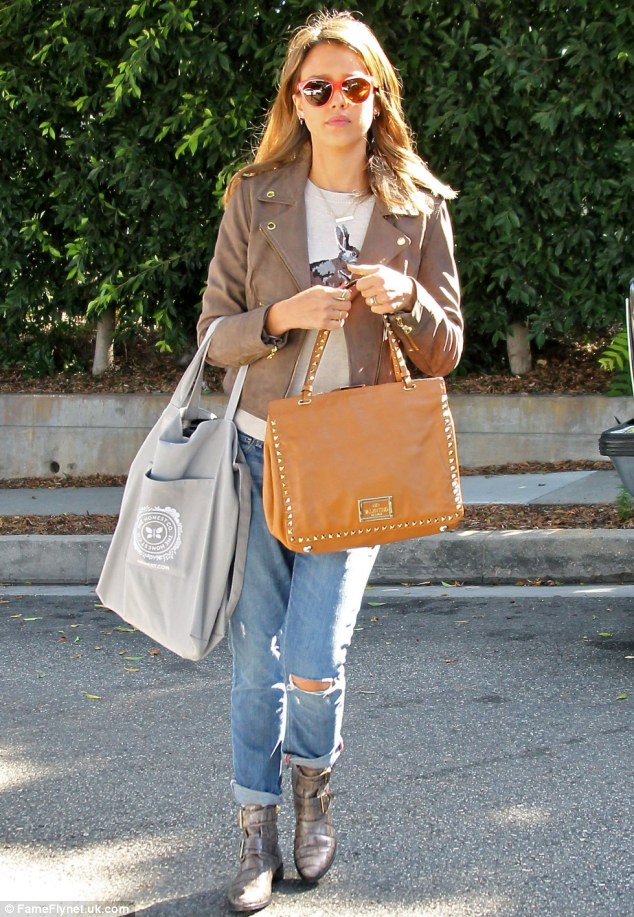 Pure jean-ius: Barely Lethal actress Jessica Alba was spotted leaving a friend's house in Brentwood, California looking chic in distressed jeans and a brown jacket