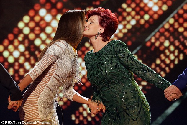 Close: Nicole gives Sharon a kiss before they take to their seats