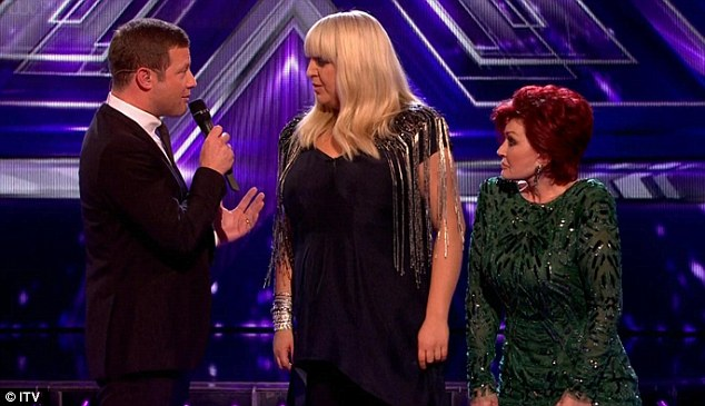 Chip off the old shoulder pad: Sharon's Dynesty-esque shoulder pads are on show as Shelley Smith learns that she will be singing for her survival on Sunday night's show
