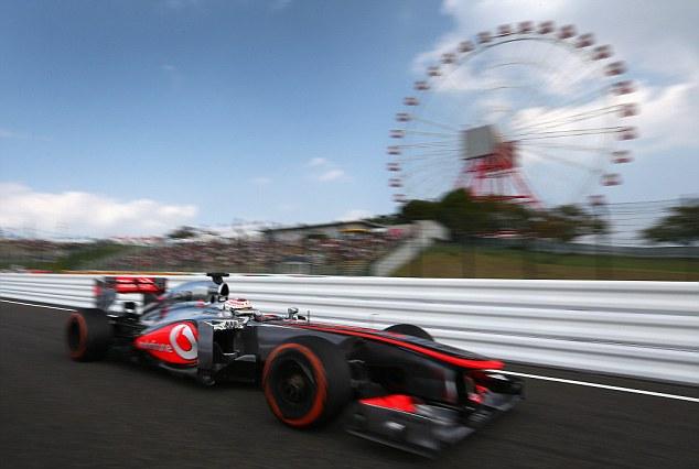 Still seeking a podium: Jenson Button flies round the Japan track