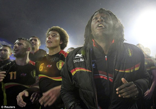 We're through: Belgium's Romelu Lukaku (right) celebrates with his teammates after their victory over Croatia in Zagreb confirmed the underdogs' place in the 2014 World Cup