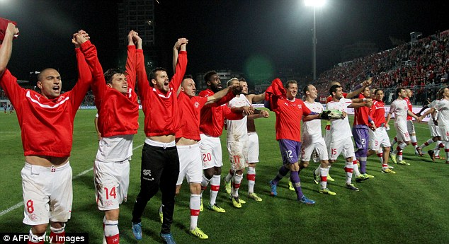 On top of the World: Switzerland's players celebrate their qualification for Brazil following a 2-1 win in Albania on Friday night