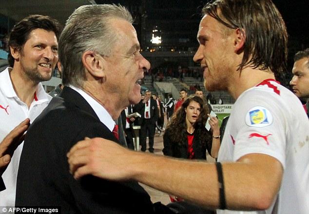 Well done: Coach Ottmar Hitzfeld congratulates defender Michael Lang