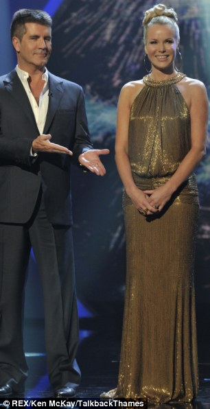Keeping up appearances: Amanda Holden, with Simon Cowell on Britain's got Talent, put on a brave face for the cameras