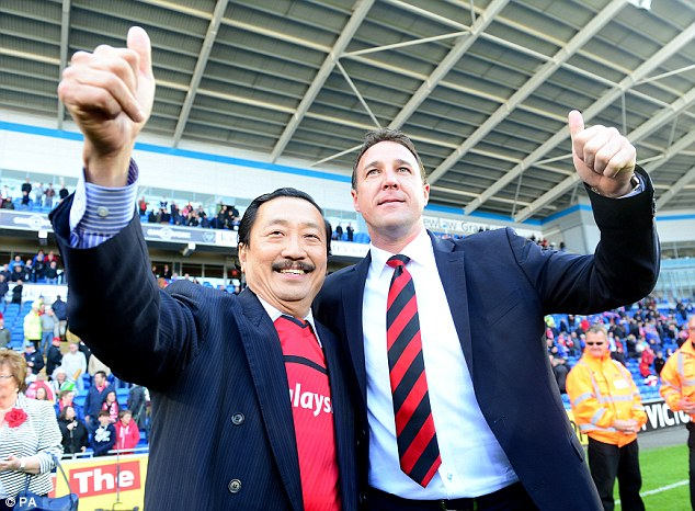 Trouble: Vincent Tan (left) with Cardiff boss Malky Mackay pictured after the former took over