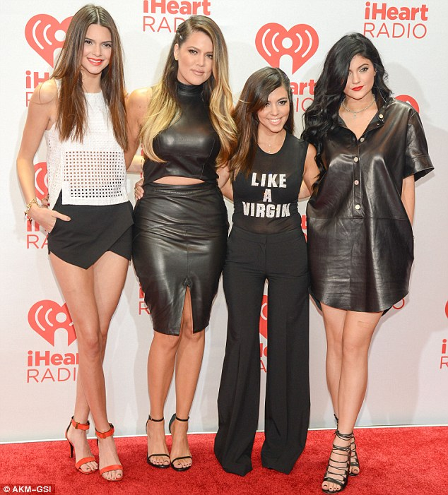 Siblings united: While Bruce and Kris go their separate ways, Khloe and Kourtney Kardashian continue to embrace Kendall and Kylie; the sisters attended the iHeartRadio Music Festival in Las Vegas on September 21