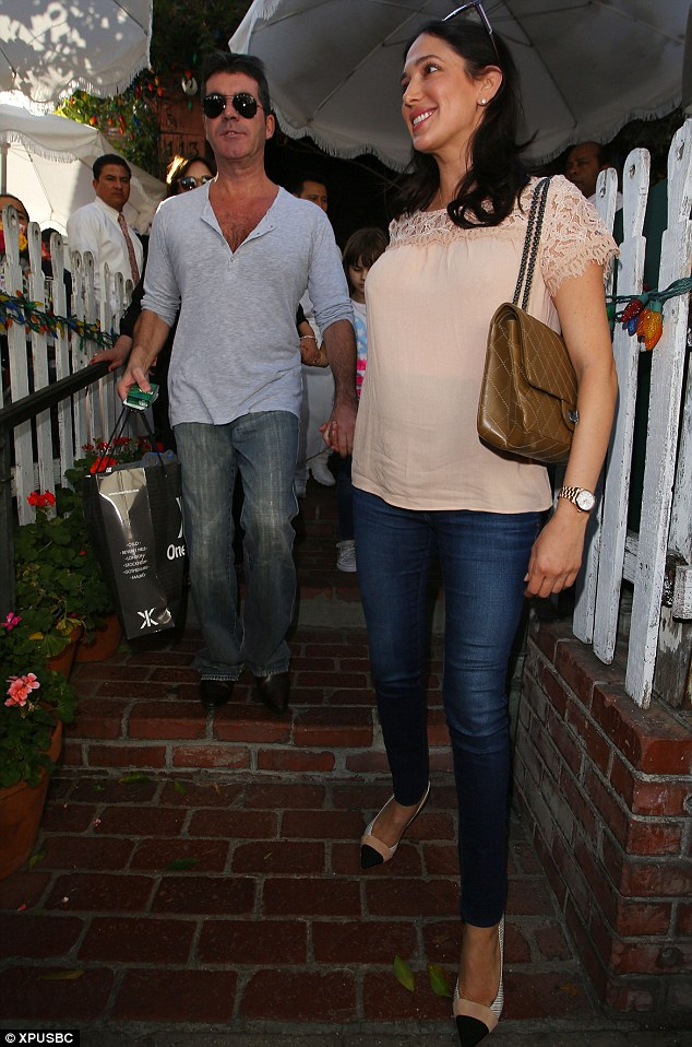 Follow me, honey: The socialite led the way as they left the restaurant, making sure Simon held onto her hand