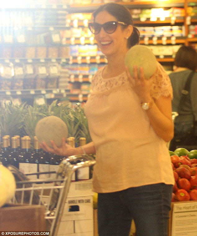 Look at my melons! Lauren joked as she showed Simon her fruit
