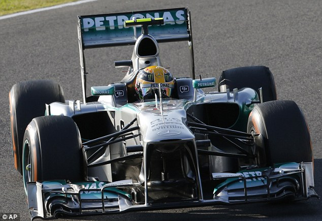 Out of the race: Hamilton retired from the Japanese Grand Prix, as Vettel claimed his fifth straight win