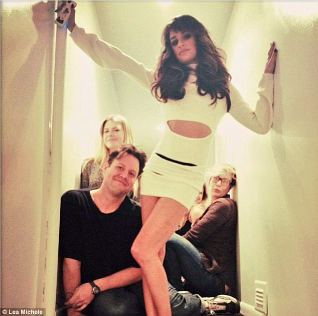 Powering on! Lea Michele shared an Instagram snap of her album cover photoshoot on Saturday, in which she wore a stunning white cut-out dress with her brunette tresses curled