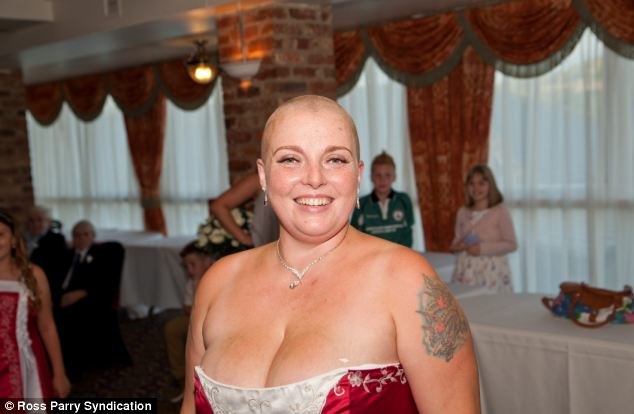 After her husband shaved the first few strands of hair from her head, a hairdresser was on hand to finish the job