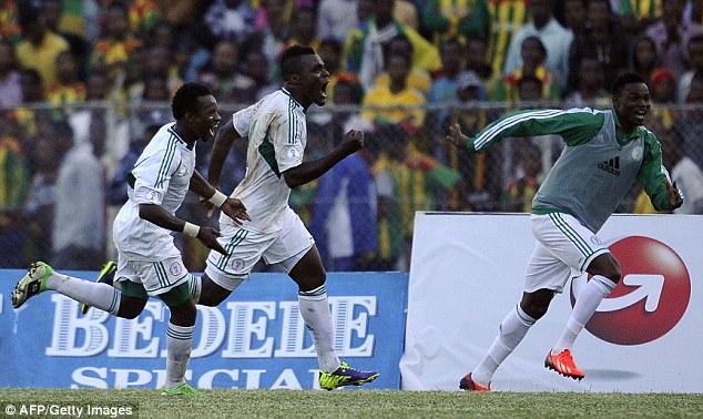 Roar of delight: Emmanuel Emenike (centre) celebrates after converting the winner from the spot