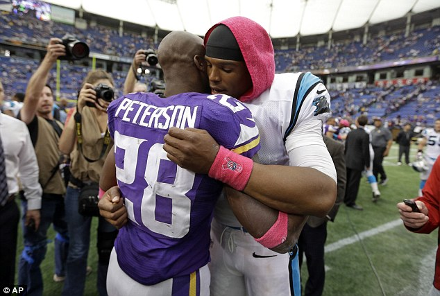 In their thoughts: Minnesota Vikings running back Adrian Peterson, left, is hugged by Carolina Panthers quarterback Cam Newton after the death of his son Ty