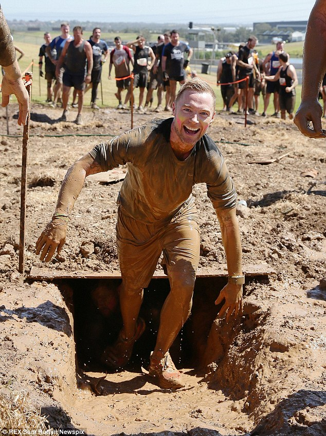 He's...smiling! Ronan Keating Competed in the Tough Mudder endurance race in Eastern Creek, Sydney, Australia