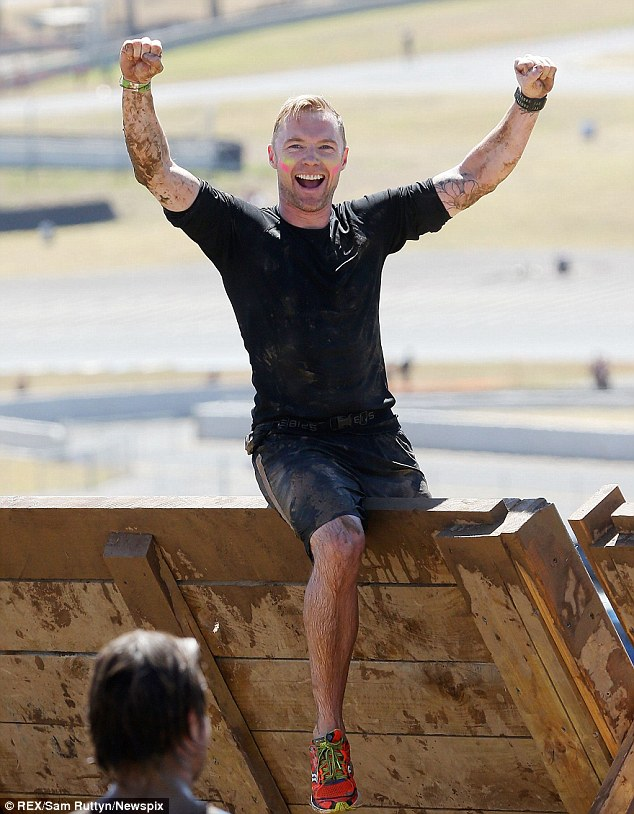It's a celebration! Ronan Keating appeared completely unphased by the course as he sat on top of a wall punching his fists in the air