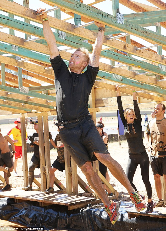 He's a natural: Ronan swung along the monkey bars with ease, with Storm right behind him