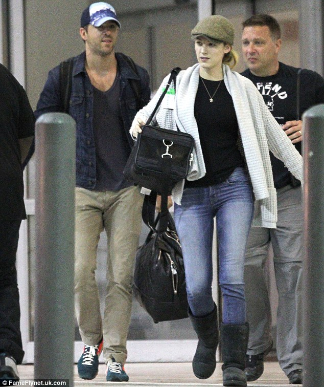 Low key couple: Ryan Reynolds and Blake Lively jetted into New Orleans airport on Sunday wearing hats and low key clothing