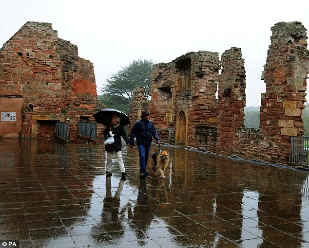 Among the ruins: People brave the rain yesterday at Rufford Abbey in Ollerton, Nottinghamshire