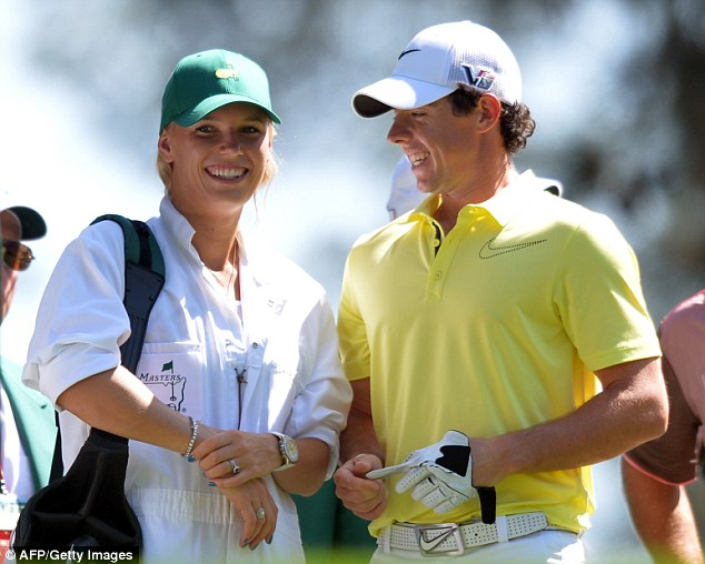 Loved up: The pair looked happy and loved-up during the par-three competition at The Masters last year