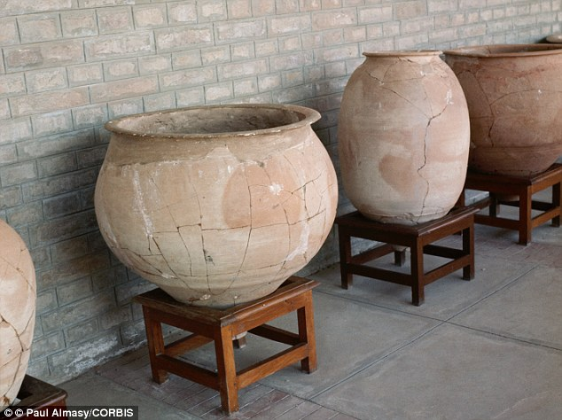 Restored pottery discovered on the ancient site lines a wall near the ruins of the ancient city of Mohenjodaro