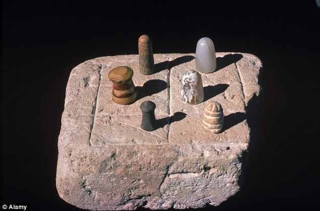 Cultured: Artefacts found by archeologists in the settlement included this chess set which is now at the Karachi Museum in Pakistan
