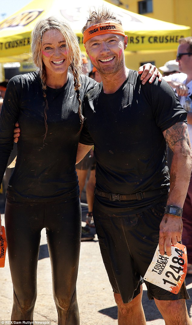 We did it! Ronan Keating and girlfriend Storm Uechtritz completed the race in two hours and 34 minutes