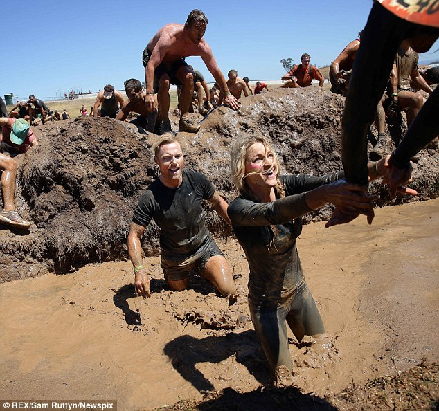 Extra help: Ronan was right behind Storm as she received help from  a fellow competitor to get herself out of a ditch