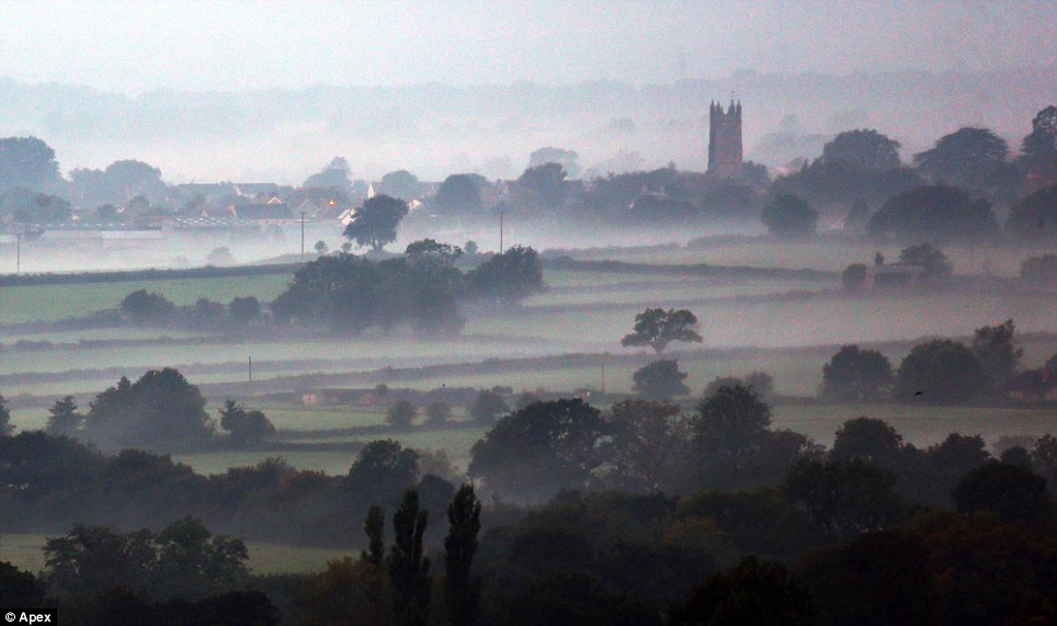 What a sight: A church can be seen in the far right of the photograph, as the beautiful morning mist rolls in near Batcombe Vale, close to Shepton Mallet in Somerset
