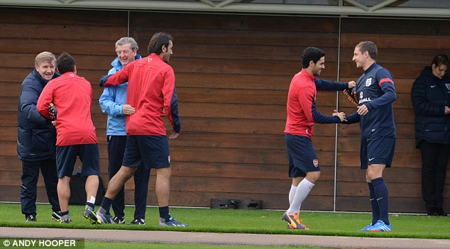Welcome: Santi Cazorla, Robert Pires and Mikel Arteta embrace some of the England set-up