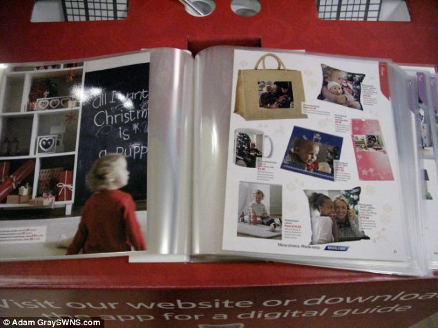 Controversy: Tesco's festive gift brochure has sparked complaints over a photograph which apparently encourages shoppers to put a puppy on their Christmas list