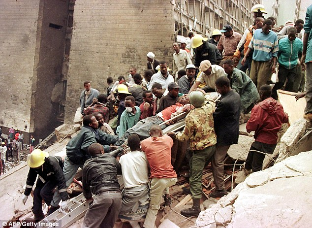 Devastating: People and firemen work to remove the bodies of people who died in the 1998 bombing of the U.S. Embassy in Nairobi, Kenya