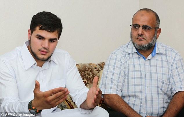 Mistrust: Abdullah al-Raghie (L), and Nabih al-Raghie, the son and brother of al-Qaeda suspect Abu Anas al-Libi, speak to the press after his capture