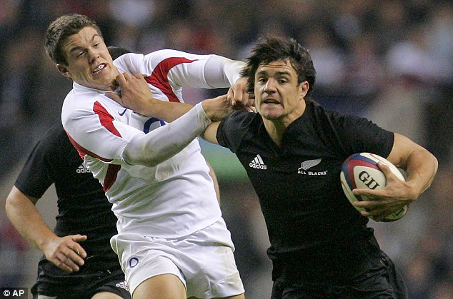 England exile: New Zealand's Dan Carter hands off England debutant Anthony Allen in 2006