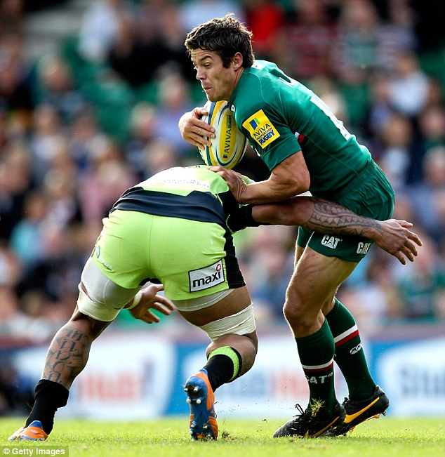 Injury blow: Anthony Allen is tackled by Samu Manoa of Northampton during the Aviva Premiership match between Leicester Tigers and Northampton Saints