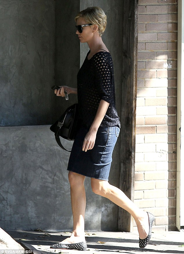 Style maven: She wore studded flats and a black sweater that sported holes, offering a glimpse of her black bra underneath