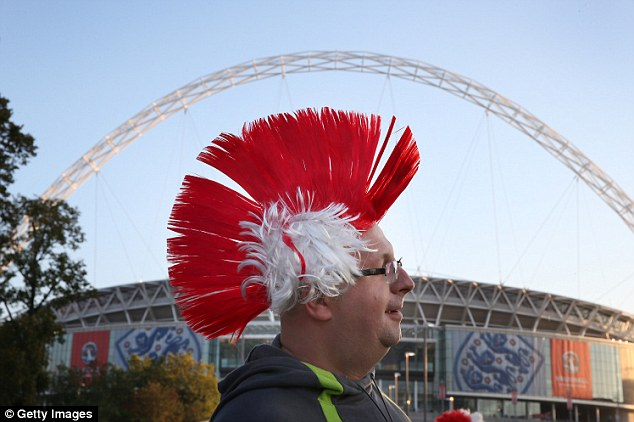 Looking good: A Poland fan mirrors the shape of Wembley's arch with some interesting headwear