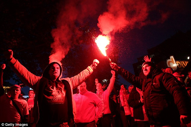 Colourful: Poland fans set off a flare on their walk down Wembley Way