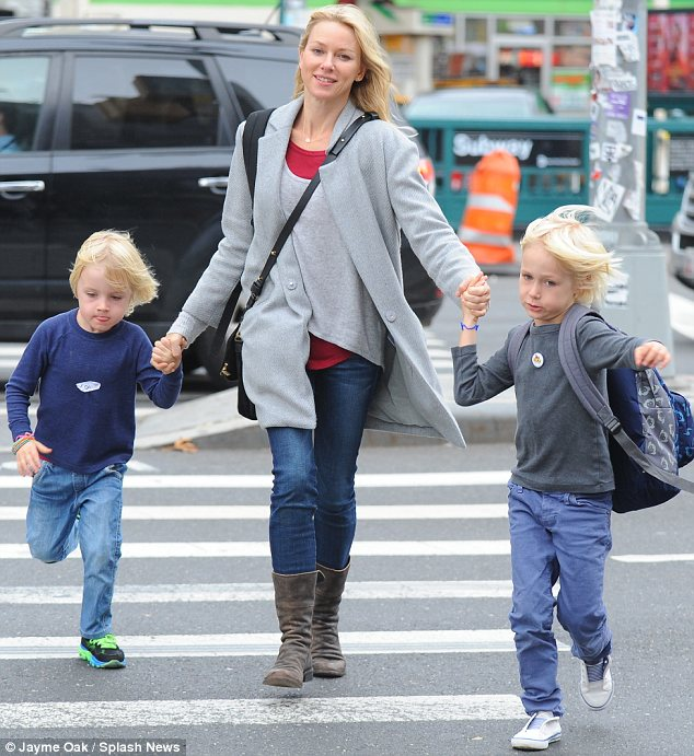 Happy family: The pair have two sons together, Sasha, six, and Kai, four, who Naomi was seen with on Friday