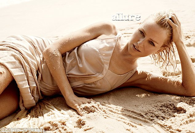 Bold: Naomi Watts posed on a beach for Allure magazine, and told them how she made the first move on Liev Schreiber