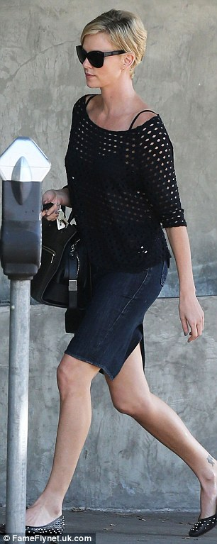 On a mission: The pair were seen striding away from the restaurant, with Charlize holding her car keys at the ready