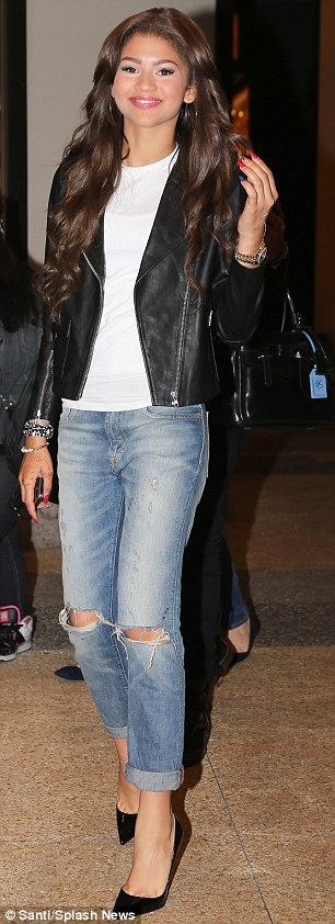 Stepping out: Zendaya was later spotted leaving the MTV studios in Times square in ripped jeans, white blouse, leather jacket and black Christian Louboutin high-heels