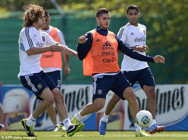 Flying home: Coloccini (left) trains with the Argentina squad in Buenos Aires last week