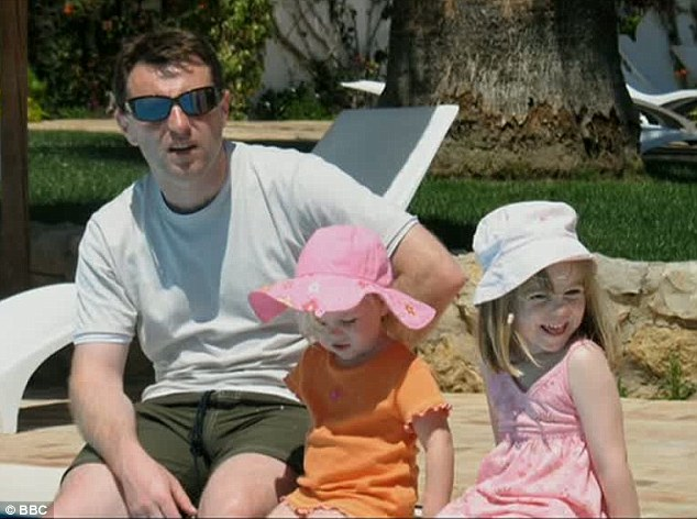 Tragedy: Gerry McCann with Madeleine (far right) splashing in the pool with their feet on the day she vanished. This is the last photo taken of the three-year-old