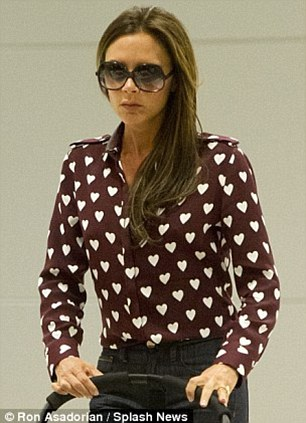 Setting the trend: The likes of Victoria Beckham and Donna Air have previously been spotted in the £495 burgundy version of the Burberry shirt